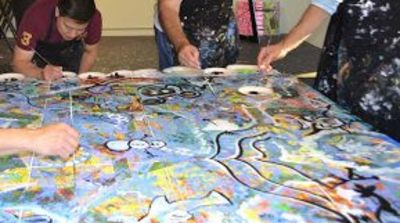 A Communication and Collaboration event painting abstract flower.
