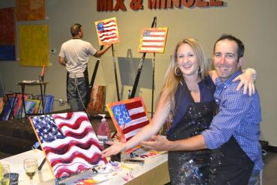 Couple with flag painting
